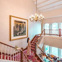 """""""Every woman's fairytale moment: Elegant chandelier, grand stairway, beautiful decor, high ceilings."""