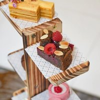 Classic Afternoon Tea: Origins is showcased on a multi-tiered stand representing Chef Ben's pastry e