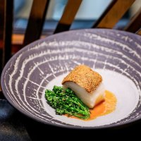 Part of Chef Adrian Chan's 6-course degustation menu, the Poached Black Cod with Pistachio Crust bri