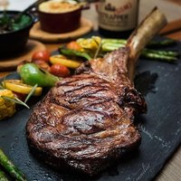 Happiness is... this Tomahawk steak at Ash & Elm. Tag someone you would like to share this with.⠀ ⠀