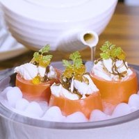 Signature Roma Tomatoes filled with crab meat, salmon ikura with yuzu dressing is delicately crafted