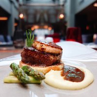 Introducing our Beef Rossini:  tenderloin and buttery foie gras served alongside grilled asparagus,