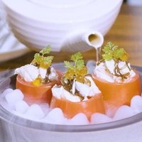 Man Fu Yuan's signature Roma Tomatoes filled with crab meat, salmon ikura with yuzu dressing is deli
